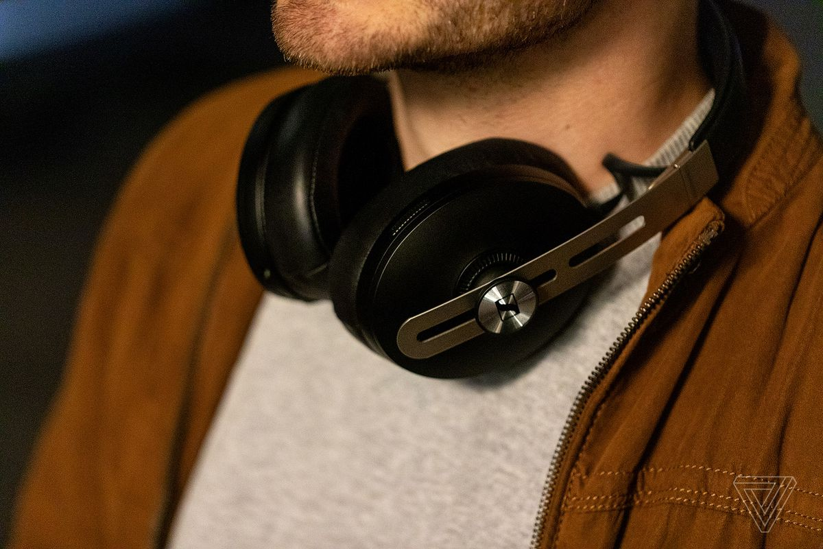 A photo of Sennheiser's Momentum Wireless 3 headphones, the best noise-canceling headphones for sound quality, worn around someone's neck.