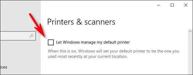 """În setările Imprimante și scanere Windows 10, debifați """"Lăsați Windows să gestioneze imprimanta mea implicită."""""""