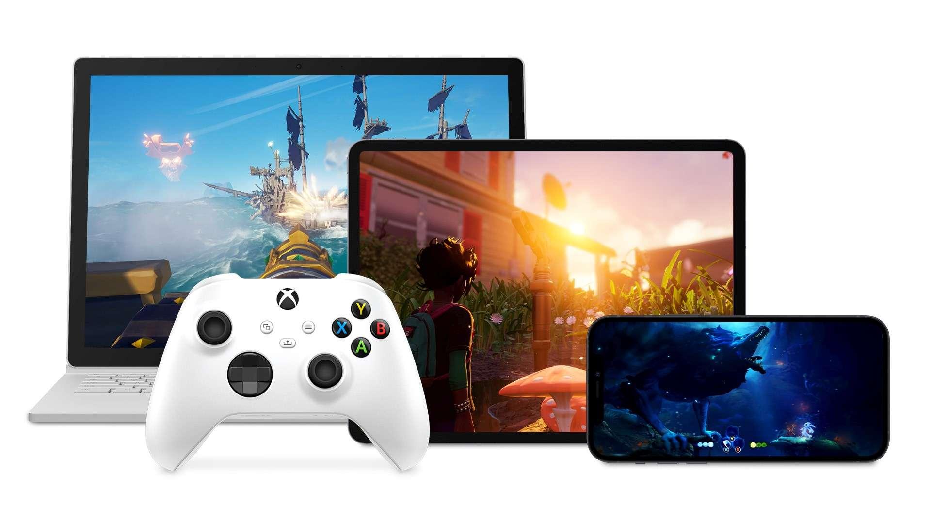 Un controler Xbox în fața unui laptop, iPad și telefon Android care joacă toate jocuri Xbox
